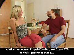 Sporty blond perfect talking with big chap in kitchen and smiling