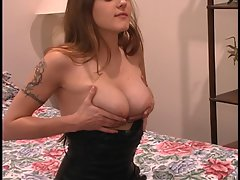 Tattooed bombshell in tough ebony dress rubs her knockers in the mirror at home