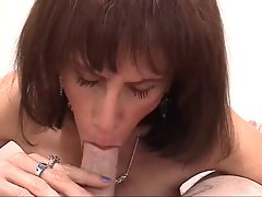 Bony aging slutbag wraps her gross knockers around white dick
