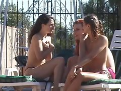Three snatch eating lezzies double penetrate with huge fake penises poolside