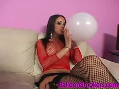 Raunchy teen playing with balloons in fishnet