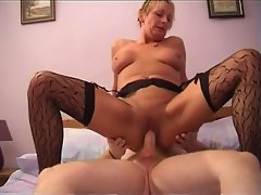 Attractive Shorthaired Experienced Puma In Stockings Rides Shaft