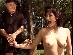 Aged men share a whore in the garden