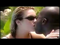 Attractive interraical tongue kissing by the pool