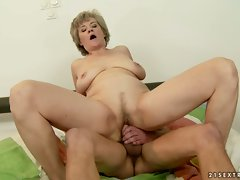 Voluptuous granny bounces her vagina on a thick boner