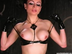 Sassy Darenzia strips off her sexual rubber outfit