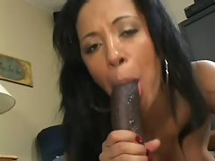 Sassy Misti Love slurps on this chocolate lolly dick