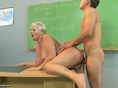 Attractive teacher Cecily receives a thick dick in her pussy from behind