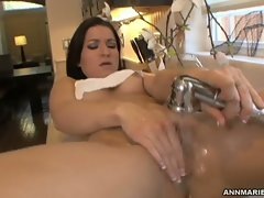 Luscious slutty girl Ann Marie teasing her cunt with water spray