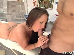 Kelly Divine grabs hold of shaft while getting massage