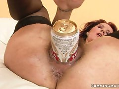 A whorish slutty girl uses a can of beer to fill her hungry filthy vulva