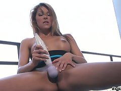 Bawdy Cindy Hope teases her quim with a vibrating sex toy