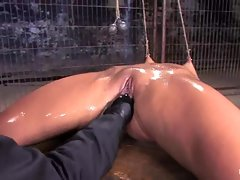Bound whore gets fisted as her friend rubs her clit with a vibrating sex toy