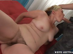 Tempting blonde Mommy wraps her lips and her very hairy cunt around a fat pecker