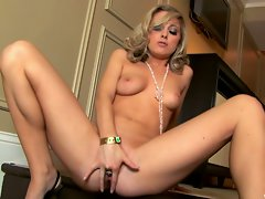 Scarlett Fay lewd tempting blonde spreads widely her vagina