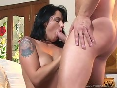 Tattooed Katrina Kravin chokes on a massive fuck stick
