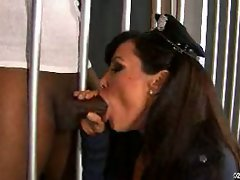 Lisa Ann cock sucking as she crouches in her police uniform