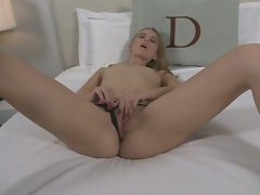 Michelle Honeywell fingering her pussy in the cozy room