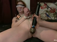 Lorelie Lee torturing a dark haired girl with a vibrating sex toy
