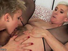 Whorish granny stroking and munching 18 years old cunt
