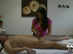 Message therapist Kiwi Ling oils up pecker and gives it a nice rough tug