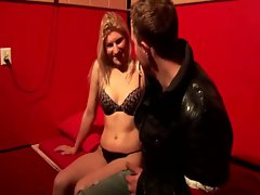 Tart in lingerie caresses phallus for her client