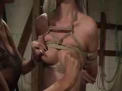 Dark haired LEZDOM domina squeezing sensual blondes knockers