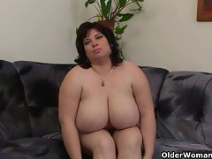 Chesty and attractive mature Fatty masturbates with vibrating sex toy