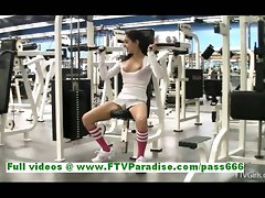 Trinity sensual dark haired female flashing knockers and slit at the gym