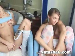 Two bombshells undress on the sofa