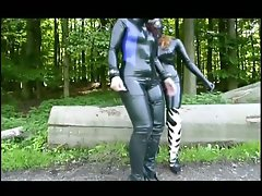 Two randy chicks in latex touch each other