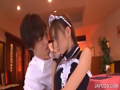 Asian maiden sensually kissing a fellow