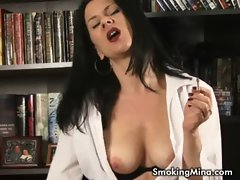 Dark haired lady smoking and stripping in the library