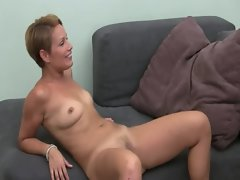 Filthy female tease with toy on couch