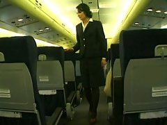 Dark haired loveliness wearing stewardess uniform gets screwed on a plane