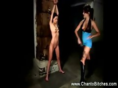 At a dungeon a wench slave gets whipped