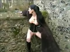 Goth Slutty girl in Furry Coat Pisses Outdoors 3