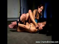 Harsh dominatrix demandes a lezzy to lick her feet