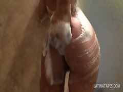 Dripping latina demonstrates bald slit and knockers in the shower