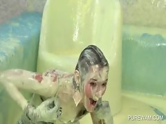 Clothed lesbians have fun in a pool of filthy paint