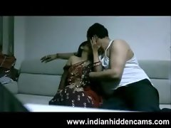 attractive mature seductive indian couple in lounge after party seducing each other alluring desire