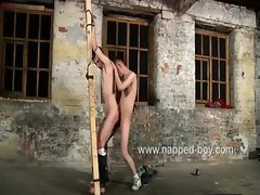 Justin James restrained against a cross