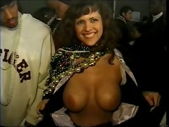 Mardi gras flasher has fabulous smile when showing knockers
