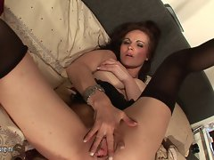 Sensual Mummy loves playing with herself on bed