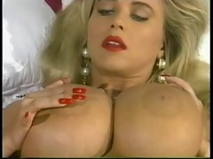 Tempting blonde With Enormous boobs Rubs Lotion On Her Body