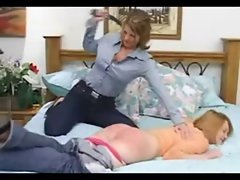 Dominate lesbo spanking another young lady
