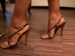 Sensual stockinged feet and superb sandals