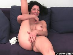 Granny in soaked panties fingering bushy and swollen vagina
