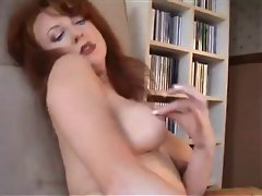 Redheaded Cougar In Retro Lingerie