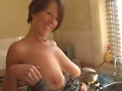 Sexual Cougar Exposes In The Kitchen